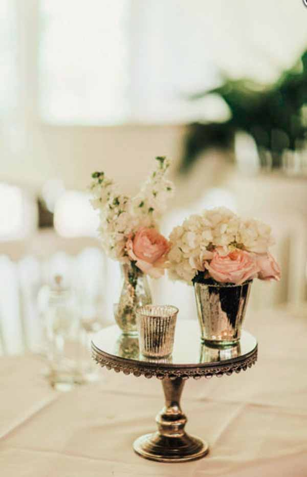 Wedding centrepiece mercury silver vases with blush pink roses on mirror cake stands by @kmorganflowers Passion for Flowers