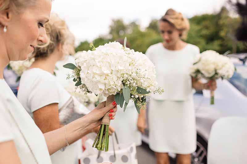 White-hydrangeas-bouquets-at-Shustoke-Farm-Barns-by-Passion-for-Flowers-@kmorganflowers
