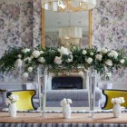 Elevated florals above long tables for weddings by Passion for Flowers shown here at Hampton Manor