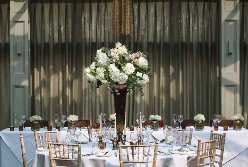 Tall wedding centrepiece bronze vases with classic white flowers at Hampton Manor Wedding - flowers by Passion for Flowers @kmorganflowers