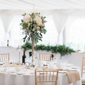 Organic free flowing wedding candelabra decorations in white marquee