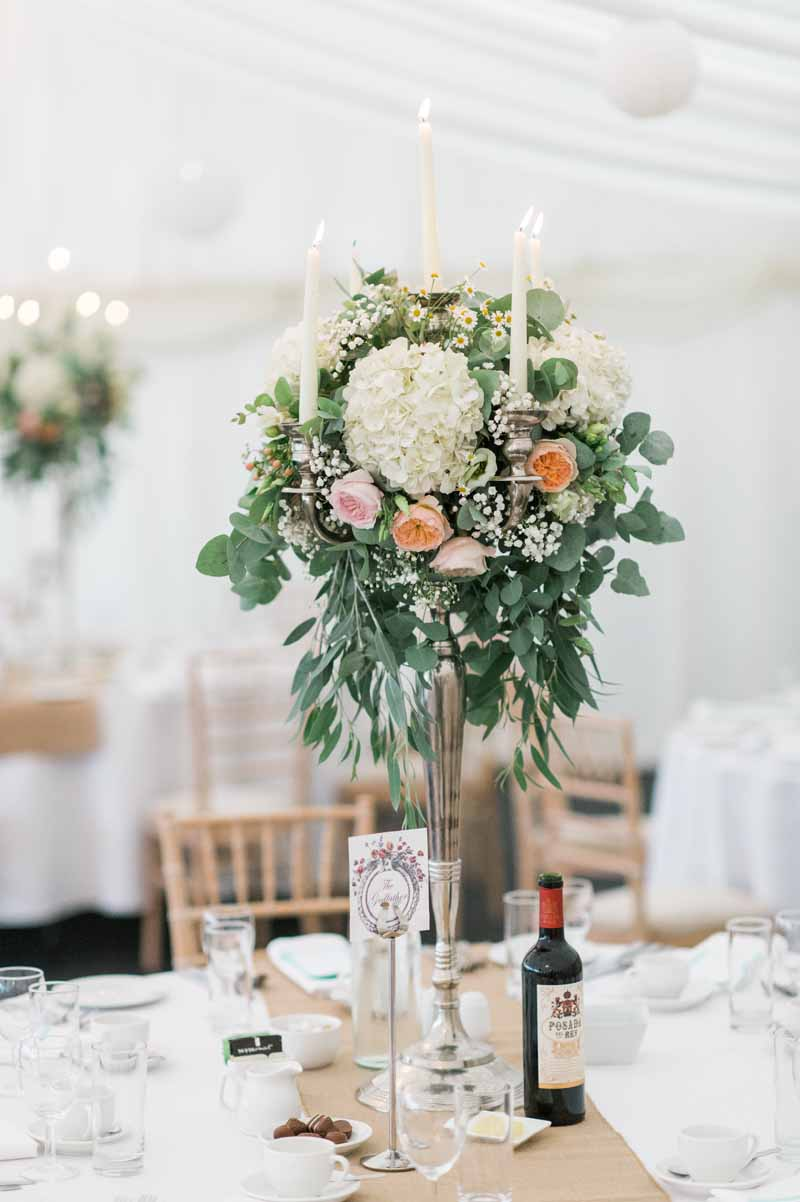 Organic style wedding candelabra centrepieces using eucalyptus hydrangeas David Austin roses and gypsophila by Passion for Flowers at Wethele Manor