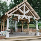 Outdoor wedding ceremony at Wethele Manor drapes and flowers by @kmorganflowers