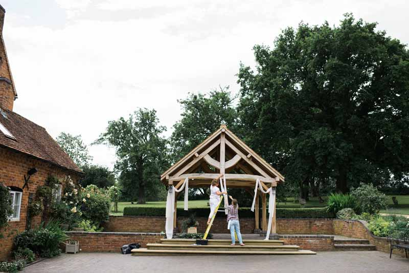 Outdoor ceremony Wethele Manor - putting up the drapes