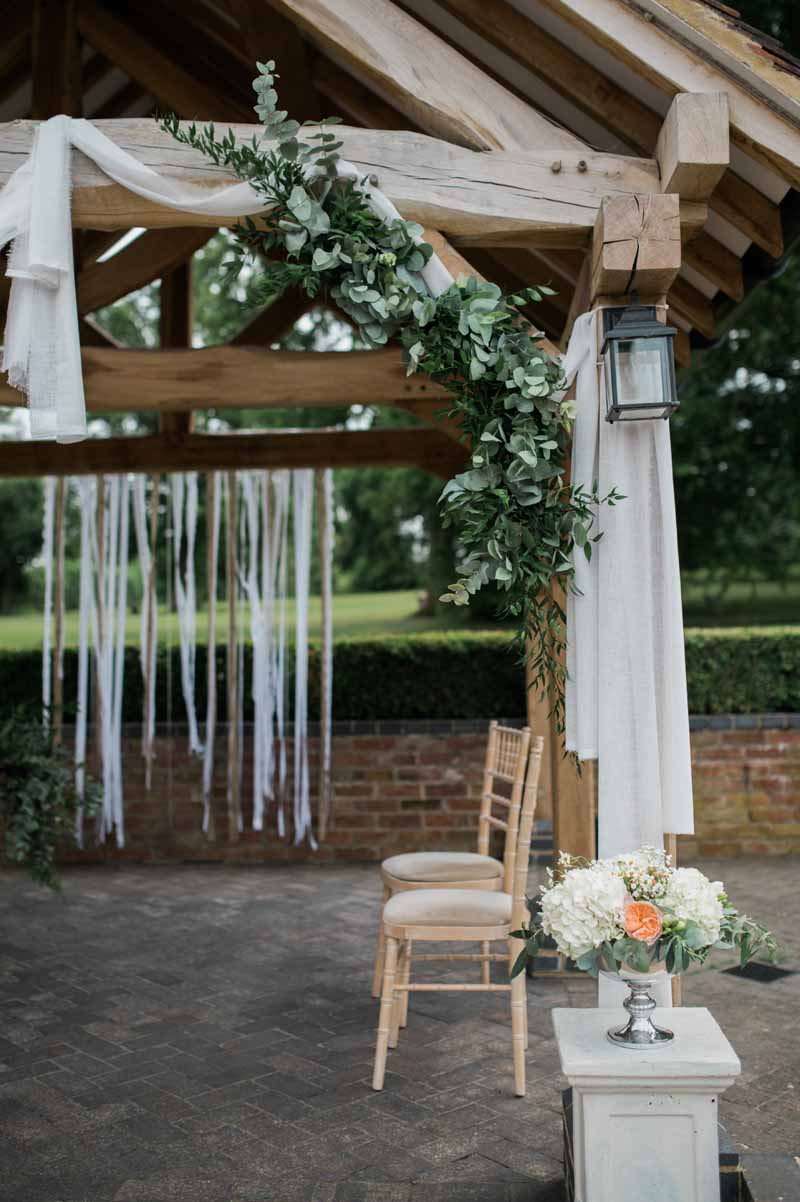 Outdoor wedding ceremony styling flowers and drapes at Wethele Manor by Passion for Flowers @kmorganflowers