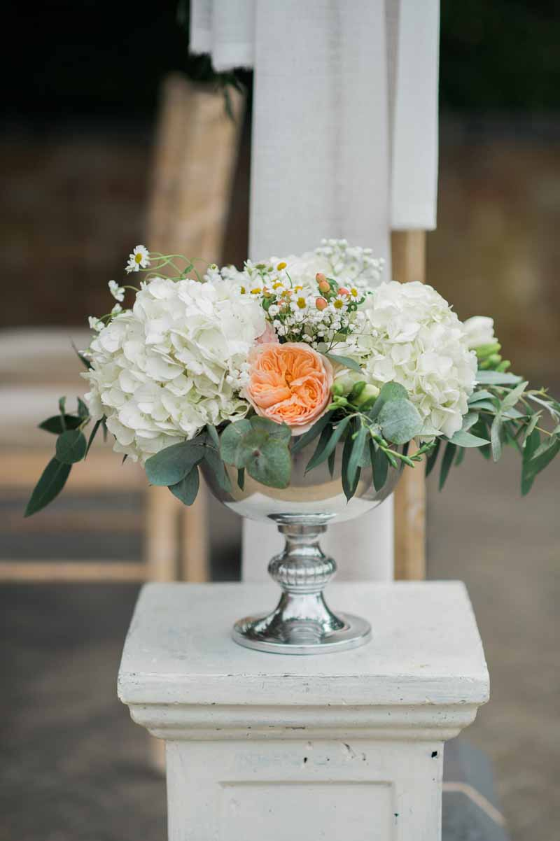 Peach and cream flowers for outdoor wedding ceremony at Wethele Manor