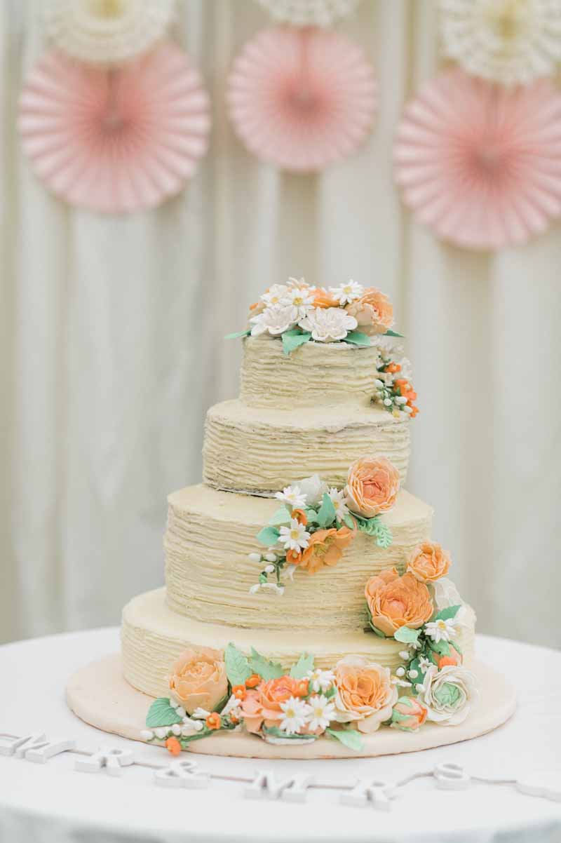 Peach rose wedding cake