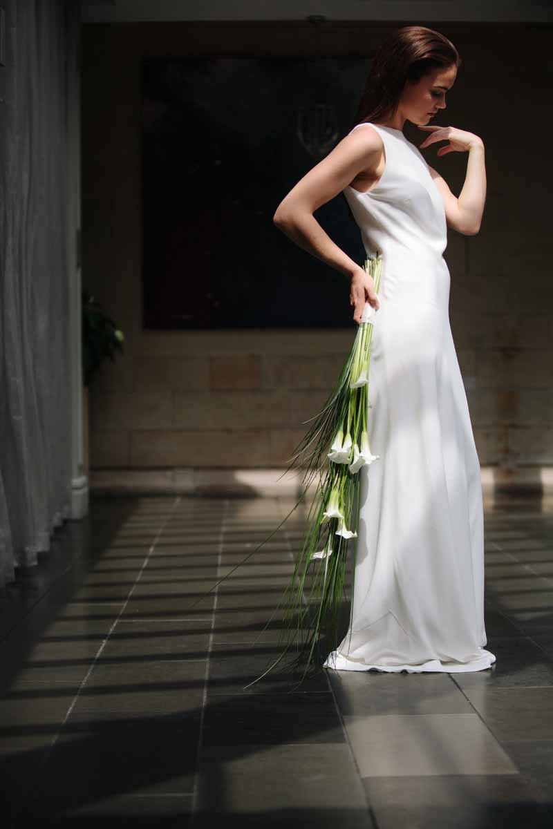 elegant long sleek bridal bouquet grasses and calla lilies