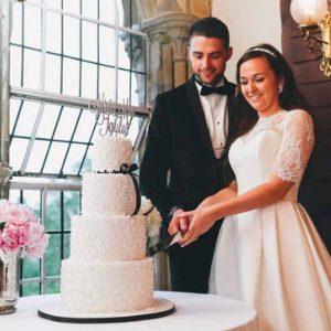 bouquet-on-wedding-cake-table-ettington-park-wedding-flowers
