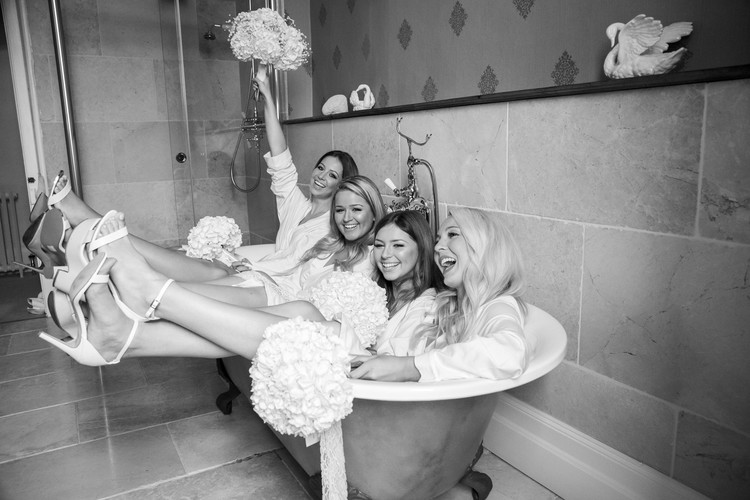 Bridesmaids in the bath at Elmore Court