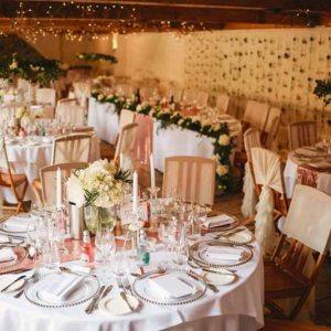 curradine barns wedding florist passion for flowers flower wall backdrop hanging flower hoops above tables and low footed bowl centrepieces
