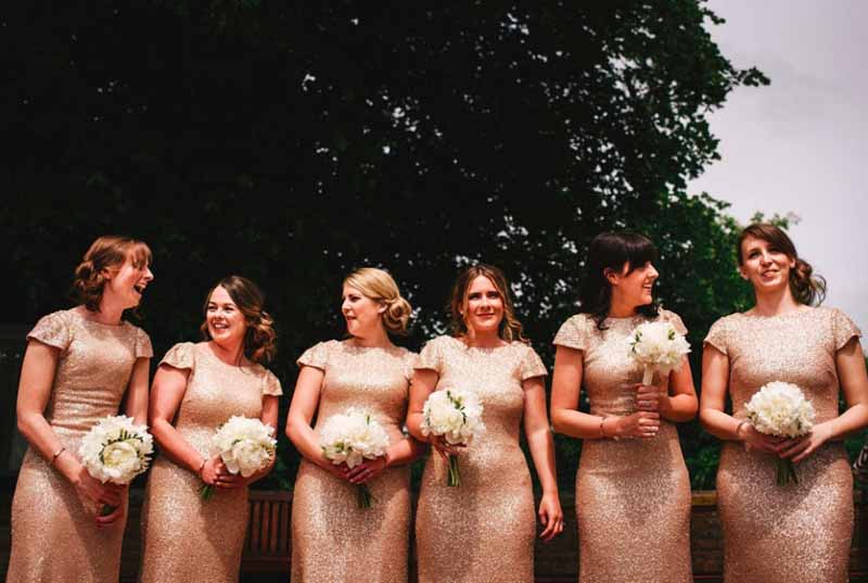 gold glitter bridesmaids dresses white peony bouquets by passion for flowers at curradine barns