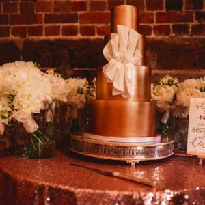 gold wedding cake glitter wedding table cloth with bouquet by passion for flowers cake sign by polly and me