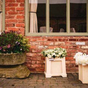 passion for flowers wedding florist setting up at curradine barns