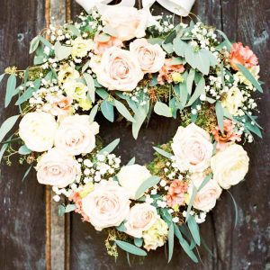 round door wreath for wedding entrance peach and grey wedding flowers by passion for flowers @kmorganflowers
