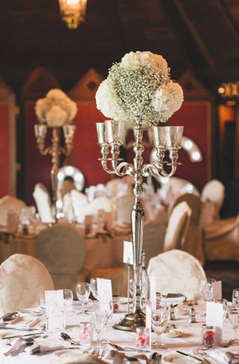 Tall-candelabra-centrepieces-Ettington-Park-Wedding-Flowers