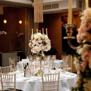 Elegant centrepieces at Hampton Manor - Passion for Flowers Candelabra centrepieces