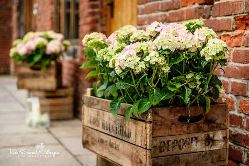 Hydrangea plants in rustic crates for entrance decorations by @kmorganflowers at Packington Moor