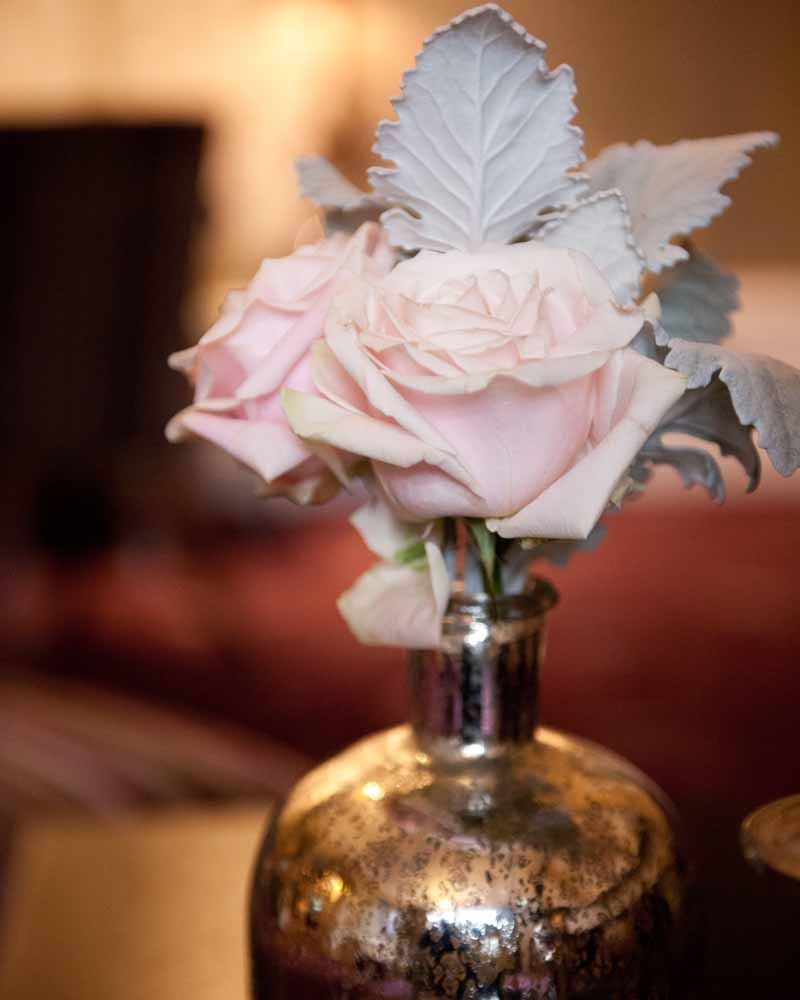 Mercury silver bottles and candle light with blush pink roses - winter wedding Hampton Manor by Passion for Flowers @kmorganflowers