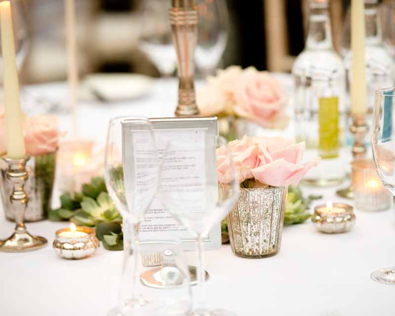 Mercury silver vases and votives with blush pink roses for winter wedding at Hampton Manor