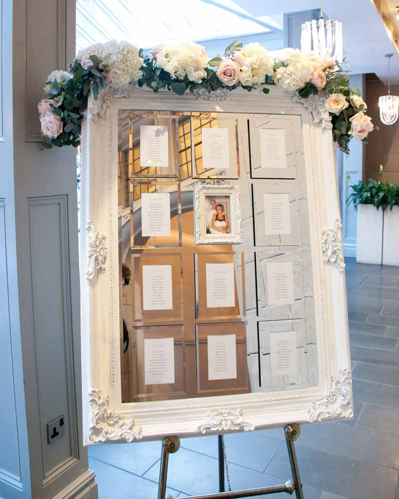 Mirror table plan floral garland by Passion for Flowers Hampton Manor Wedding Florist