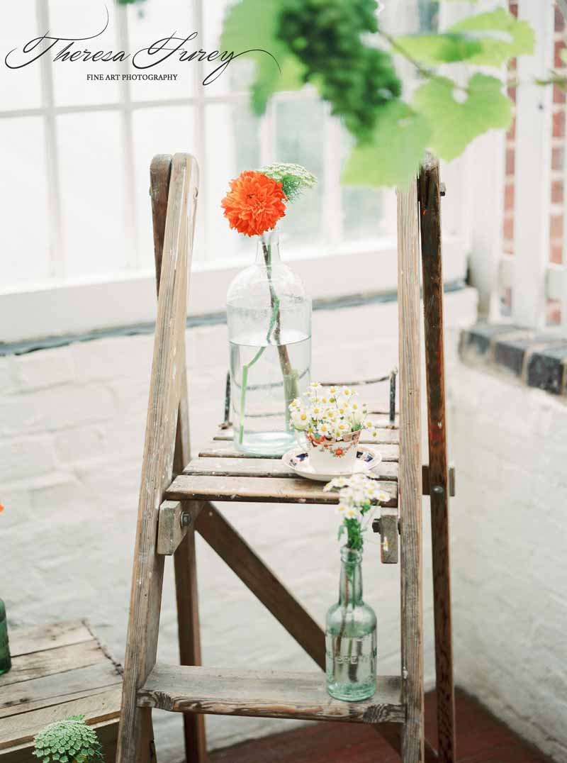 Rustic ladders wedding display with apothecary bottles by Passion for Flowers @kmorganflowers
