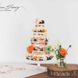 Rustic wedding cake flowers for summer wedding orange and yellow by Passion for Flowers @kmorganflowers