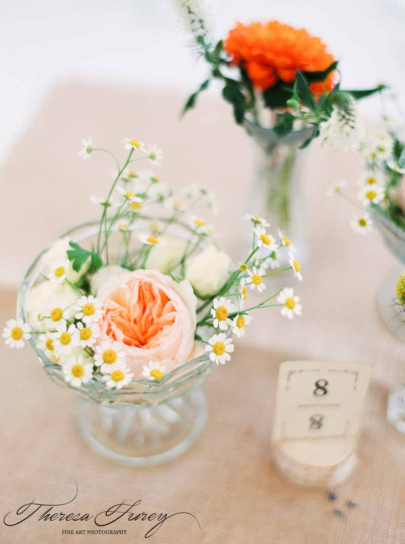 Wedding centrepieces bright summer flowers in crystal glass vases for relaxed summer wedding by Passion for Flowers @kmorganflowers