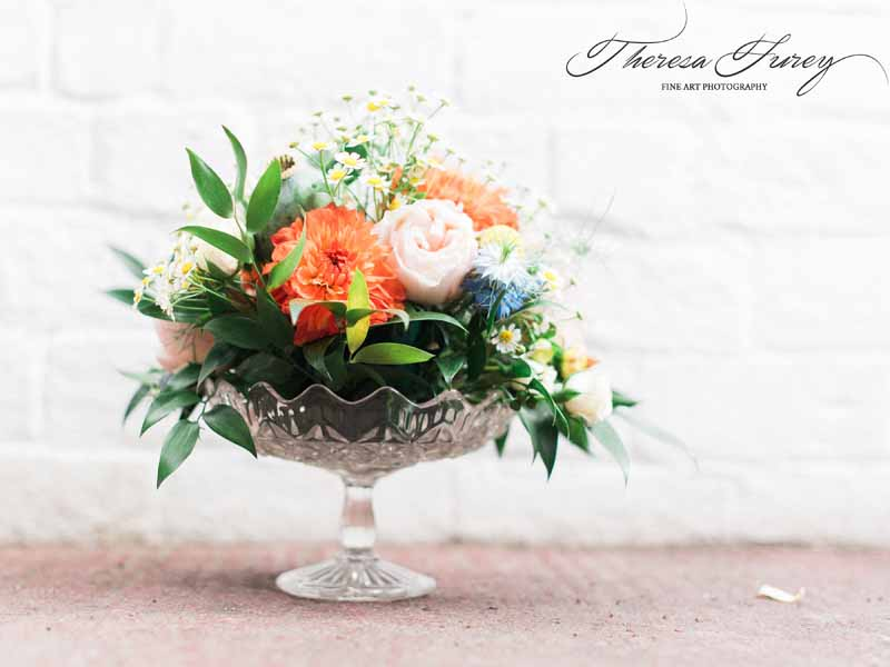 Wedding centrepieces bright summer flowers in crystal glass vases for relaxed summer wedding by Passion for