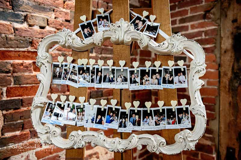 how to display photos at weddings with frame and wooden heart pegs
