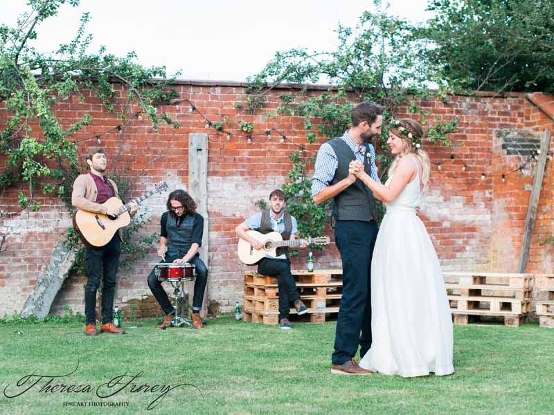 relaxed summer wedding first dance in garden with crate furniture