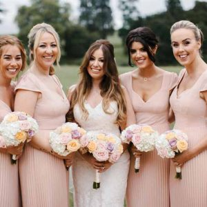 blush-pink-bridesmaids-dresses-with-rose-bouquets-at-compton-verney
