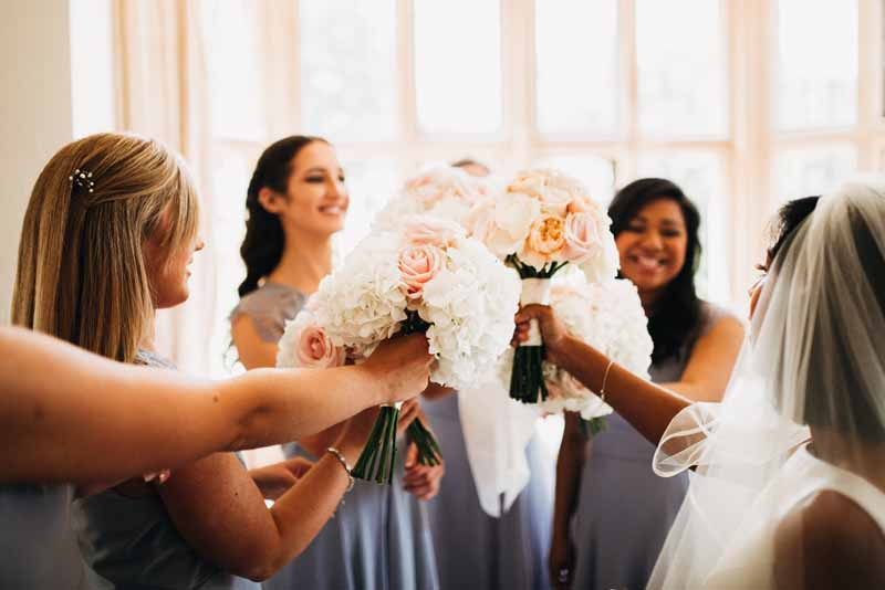 bridesmaids-bouquets-peach-and-blush-pink-roses-grey-dresses-coombe-lodge-bristol