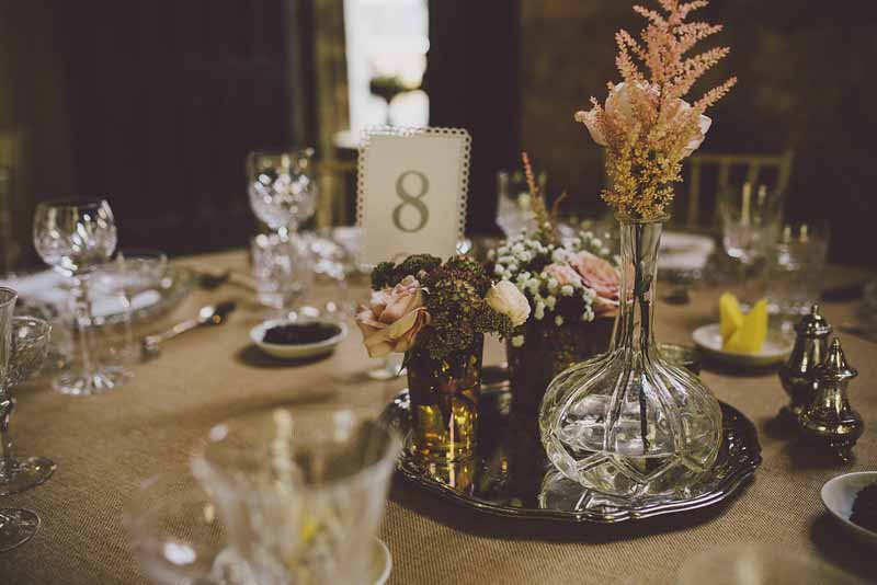 crystal-glass-vases-and-silver-wedding-centrepieces-at-sudeley-castle-by-passion-for-flowers-3
