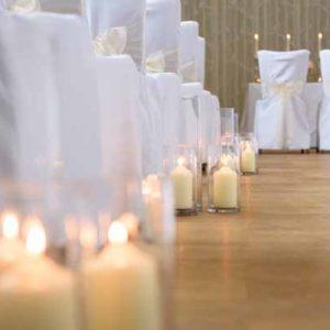 cylinder-vase-lanterns-down-the-aisle-indoor-wedding-ceremony