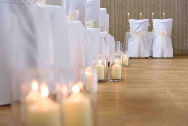 cylinder-vase-lanterns-down-the-aisle-indoor-wedding-ceremony
