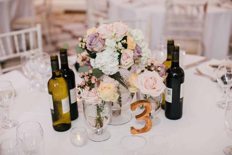 elegant-colourful-wedding-centrepieces-with-gold-table-numbers