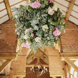 Extra-large-hanging-flower-balls-at-barn-weddings-by-Passion-for-Flowers-@kmorganflowers