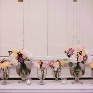 glass-footed-bowls-of-pink-purple-peach-roses-for-wedding-centrepieces-compton-verney-2