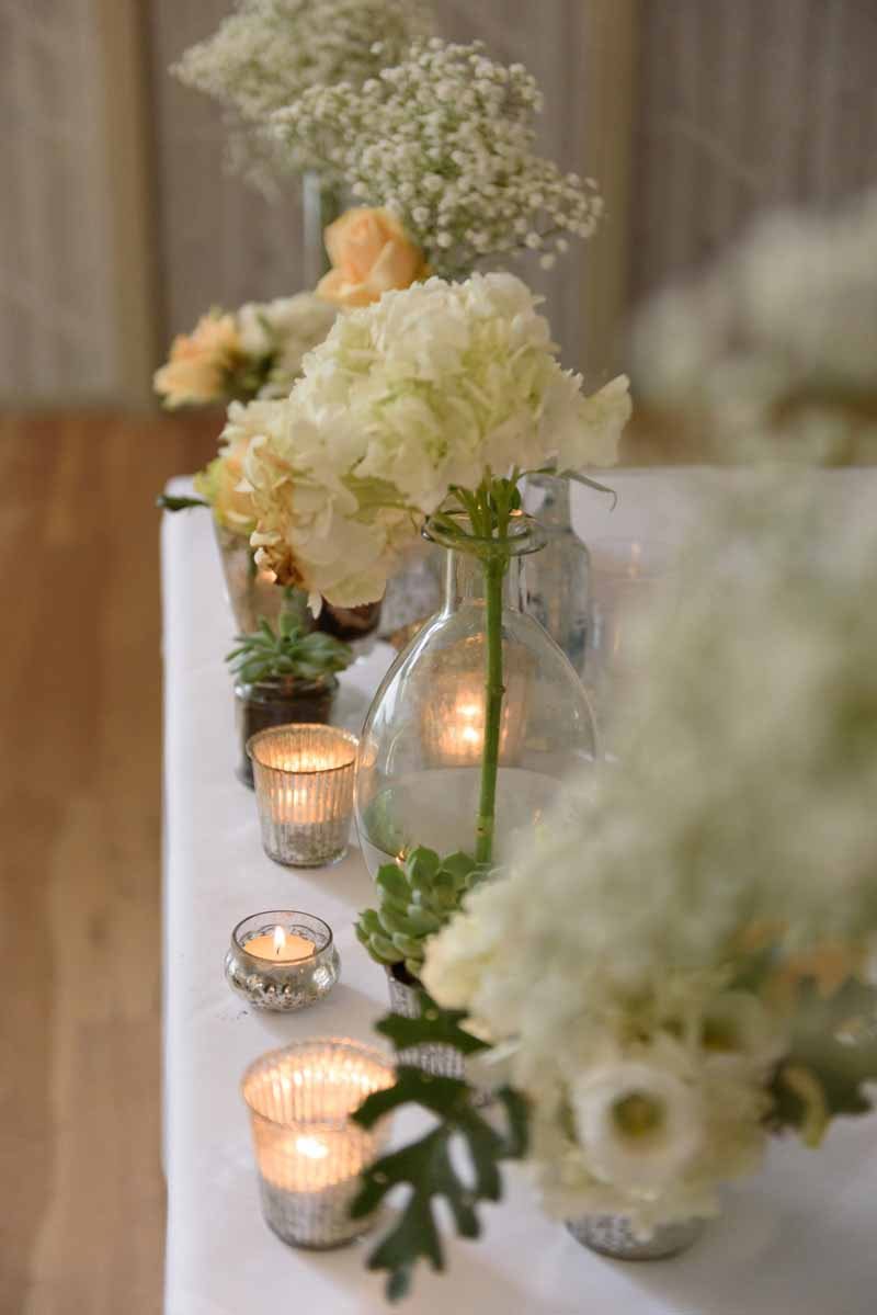glass-vases-for-wedding-ceremony-tables-white-and-peach-flowers-by-passion-for-flowers-3