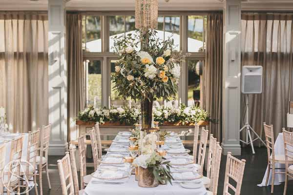 hampton-manor-wedding-tall-centrepieces-bronze-vases-peach-roses-florist-passion-for-flowers