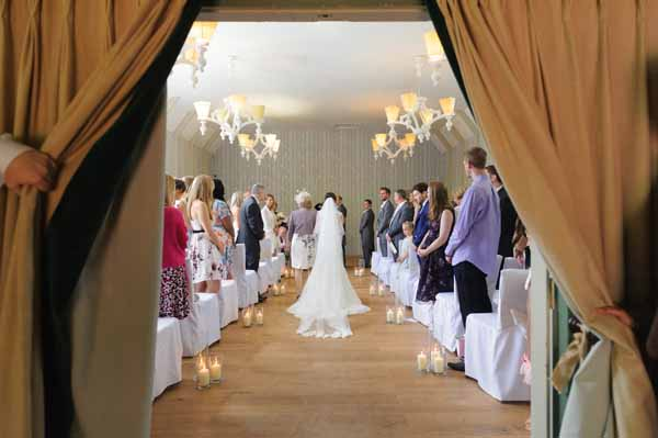 hampton-manor-wedding-ceremony-lanterns-down-aisle-1