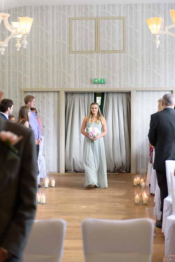 hampton-manor-wedding-ceremony-lanterns-down-aisle-2