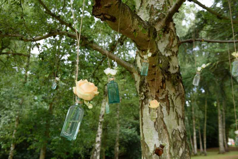 hanging-roses-in-apothecary-bottles-wedding-flowers-1