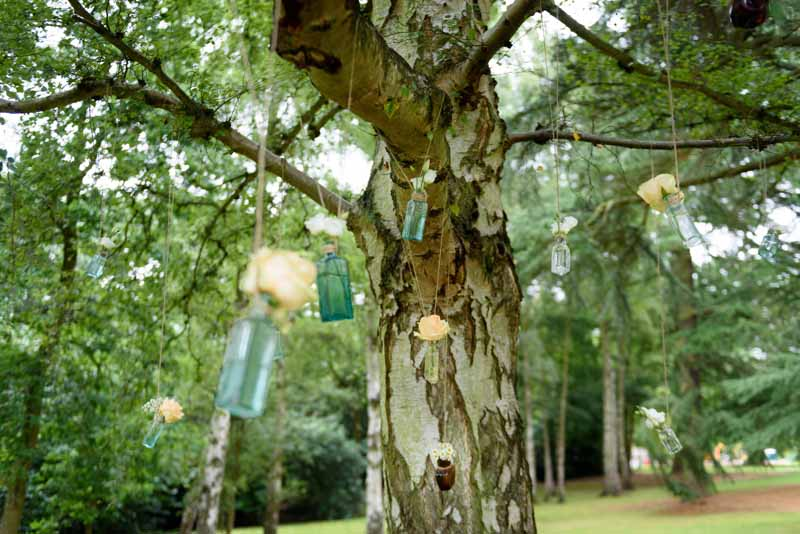hanging-roses-in-apothecary-bottles-wedding-flowers-2