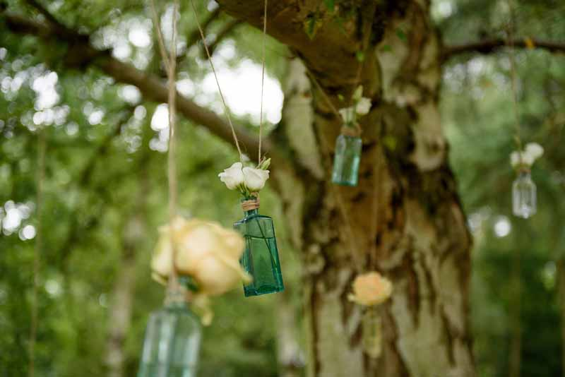 hanging-roses-in-apothecary-bottles-wedding-flowers-3