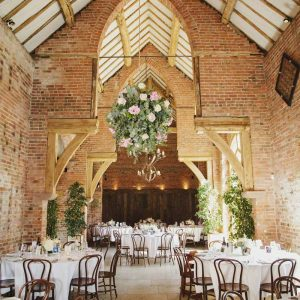 Large-hanging-flower-globes-in-barn-wedding-venue-by-Passion-for-Flowers