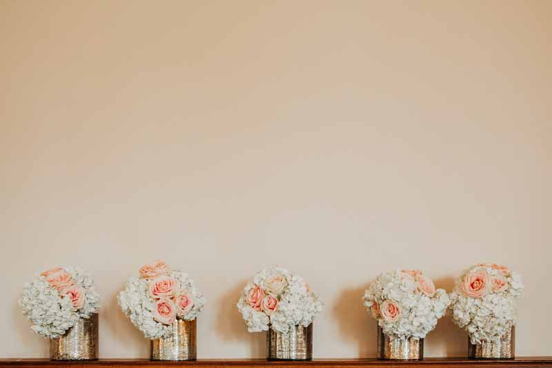 Peach wedding flowers passion for flowers luxe gold vases wedding centrepieces of white hydrangeas junglespirit Gallery