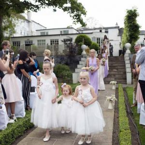 outdoor-wedding-ceremony-at-warwick-house-jugs-down-the-aisle-1