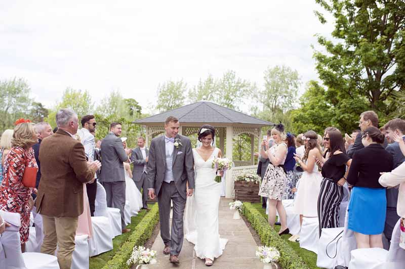 outdoor-wedding-ceremony-at-warwick-house-jugs-down-the-aisle-2